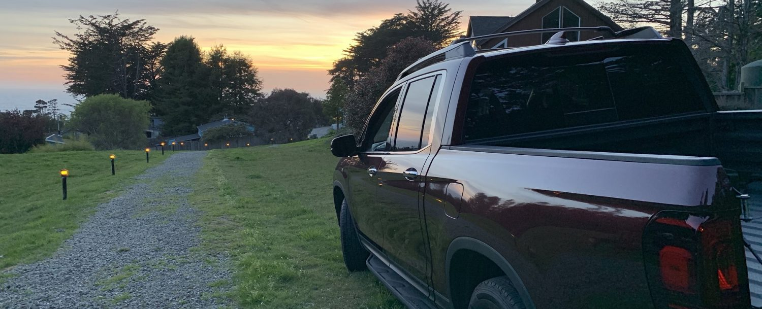 truck near gravel road, mendocino sunset