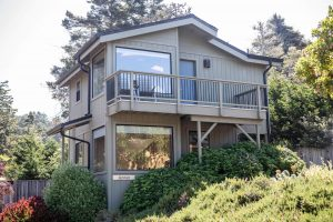 exterior of two story cottage in mendocino with balcony